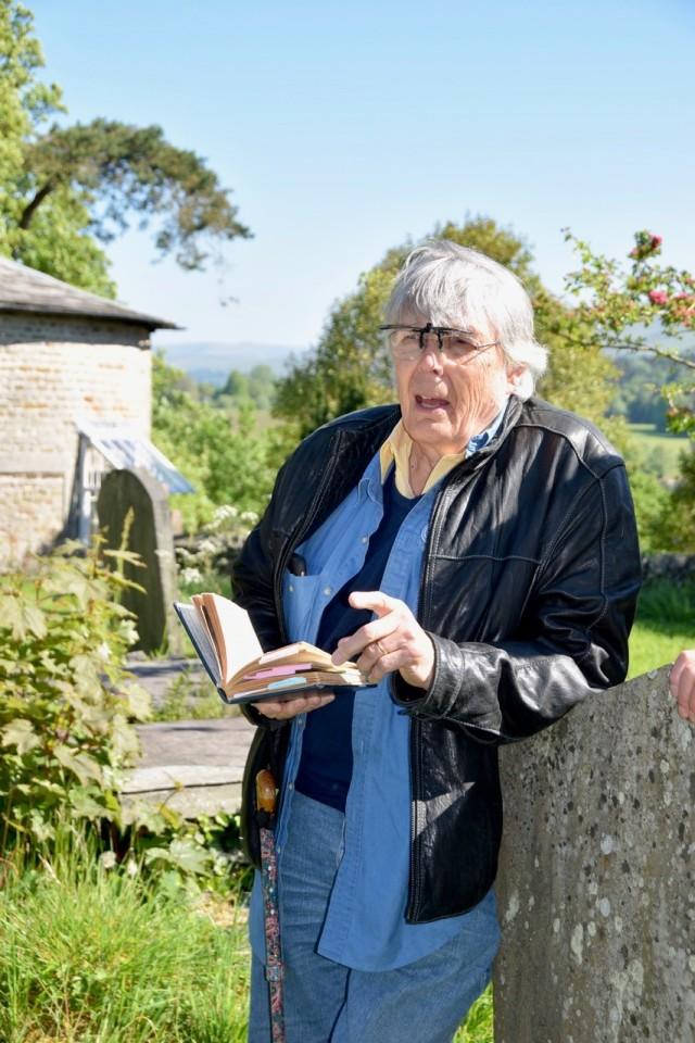 Wendy Ward Jim reading from Of Kings Treasuries in Kirkby Graveyard 2019